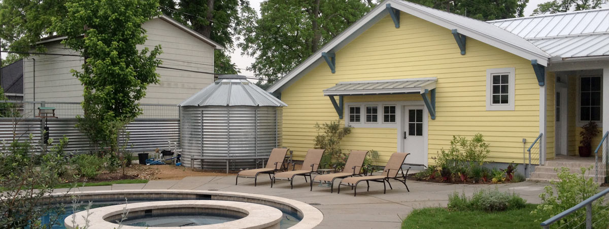 Above-ground tank storage solution in the backyard of a residential property in Houston.